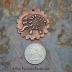 Embossed Elephant Focal with Spiral/Ammonite texture and scalloped edge.