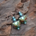 Striking Lampwork Beads paired with Faceted Czech glass beads.