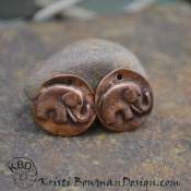 Adorable Copper Elephant pair.